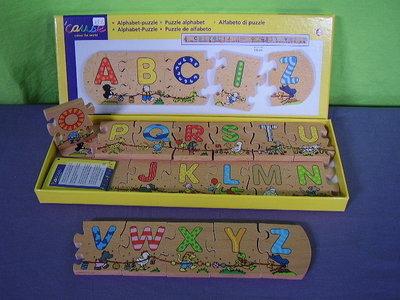 Houten alfabet puzzel cause.