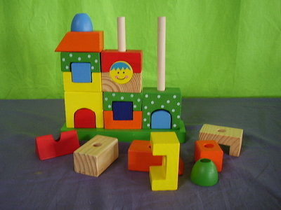Houten bouwpuzzel huis